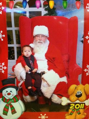Aiden Torres with Santa at age 2 in December 2011